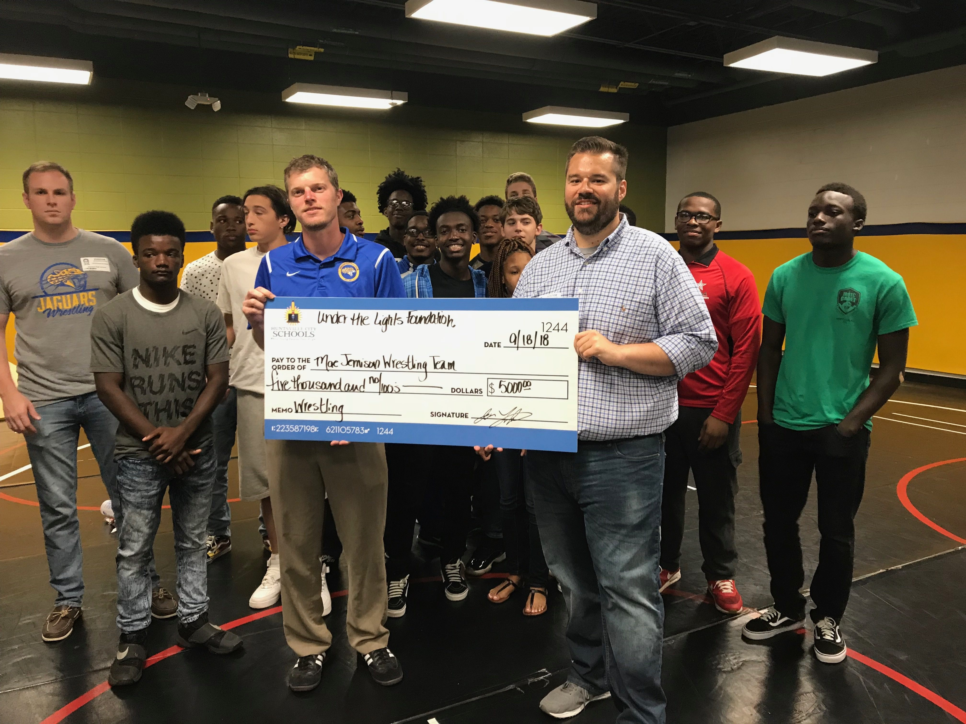 Under the Lights awards first grant to Mae Jemison wrestling team